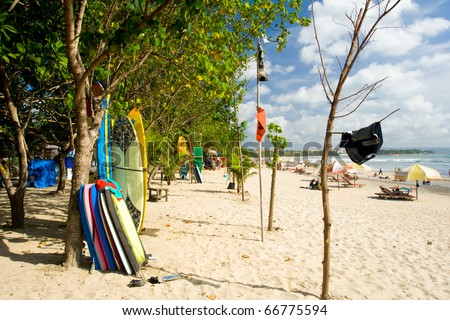 Surfboards and Bodyboards are available for rent and lessons to tourists on Kuta Beach in Bali, Indonesia.