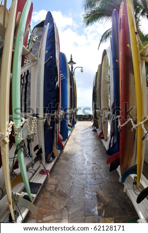 Surfboards hanging on a public rack at famous Waikiki Beach in Oahu. Hawaii.