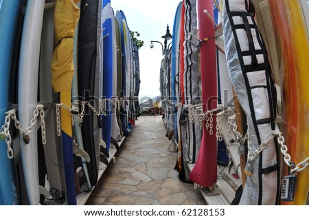 Surfboards lined up in the rack at famous Waikiki Beach. Oahu, Hawaii.