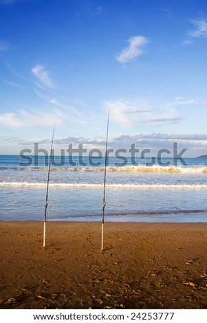 Surfcasting rods in the sand at Taipa Beach on a beautiful summers evening, Northland, New Zealand