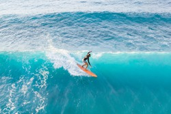 Surfer at the top of the wave, top view