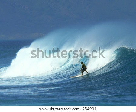 Surfer catches a good ride in Maui's heavy surf.