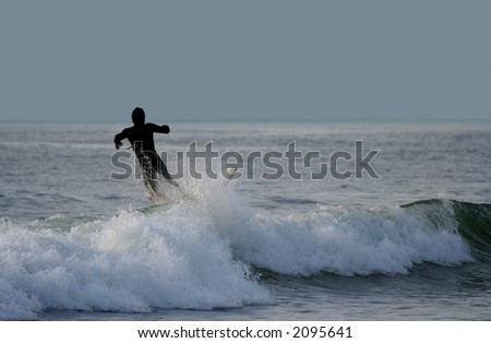Surfer falling in the sea