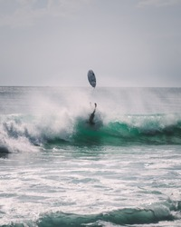 surfer falling upside down, board in the air. Surf wipeout fail