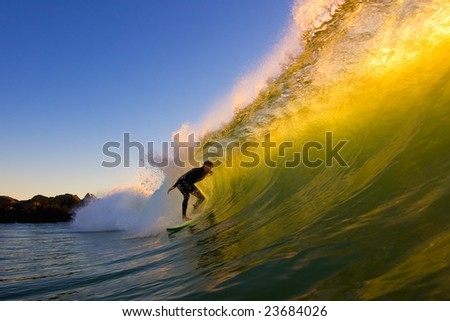 Surfer Gets A California Tube at Sunset