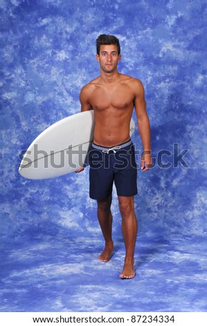 surfer holding a surfboard (studio photo)