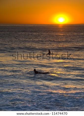 Surfer in Sunset in Windansea, La Jolla, California