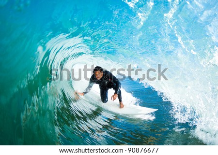 Surfer in the Barrel on Amazing Blue Ocean Wave - stock photo