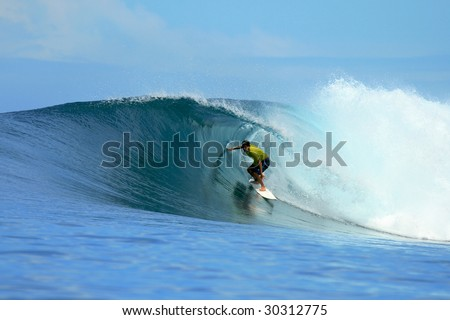 Surfer in yellow t-shirt in barrel, Mentawai Islands, Indonesia