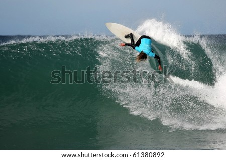 Surfer making a radical turn on a large wave