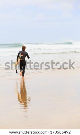 Surfer on a beach