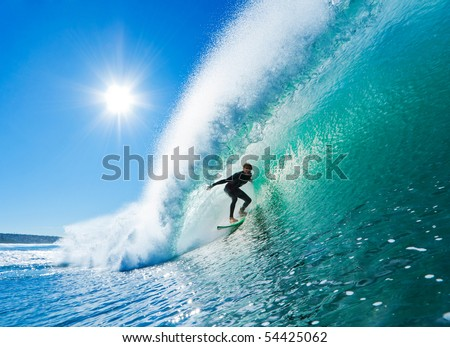 Surfer on Amazing Blue Wave in the Barrel, Epic Tube - stock photo