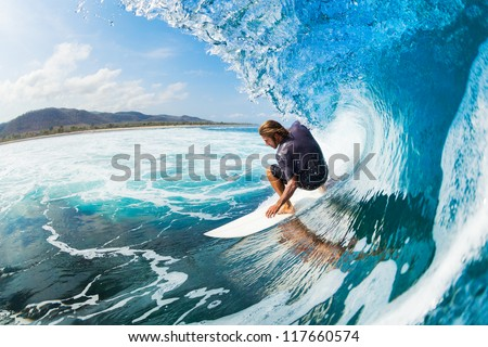Stock Photo Surfer on Blue Ocean Wave in the Tube Getting Barreled