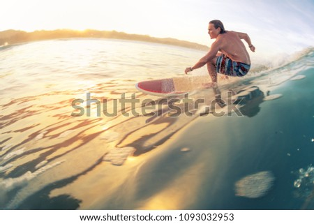 Surfer rides the wave in tropics at sunrise. Costa Rica #1093032953