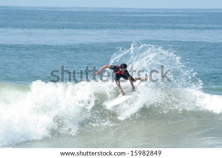 surfer riding a perfect wave and doing tricks