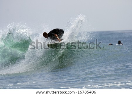 surfer riding the crest of a wave