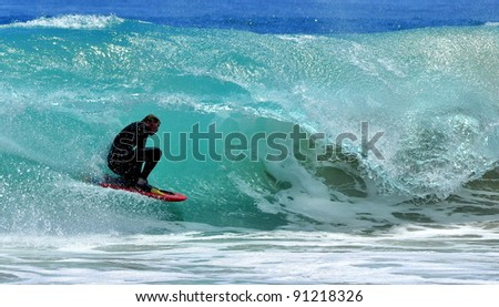 Surfer surfing wave off the coast of Western Australia - stock photo