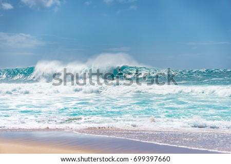 Surfer tackles big drop in at pipeline #699397660