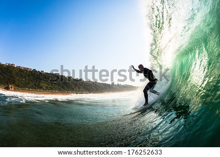 Surfer Wave Dropping Balance Surfer dropping down upright hollow surging wave in critical position, a water view of action. #176252633