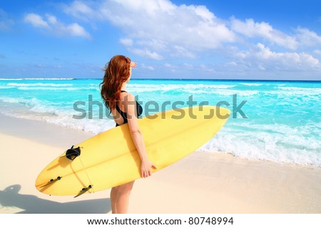 surfer woman side view in a tropical sea looking waves from Caribbean sea
