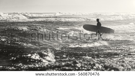 Surfers on an ocean beach. silhouette of the surfer