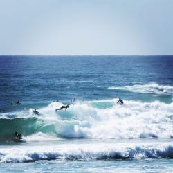 Surfers on the broken head beach surf spot near Byron Bay, Australia