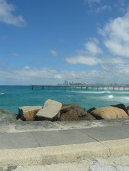 Surfers paradise and the sand pumping jetty along the seaway of goldcoast in queensland - australia