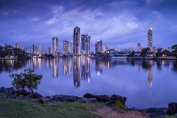 Surfers Paradise city skyline on dusk with perfect reflection on water and dramatic sky background, Gold Coast, Queensland, Australia