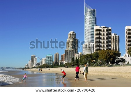 SURFERS PARADISE - SEPT 8: Holiday-makers take an early morning stroll on the beach at Surfers Paradise, Queensland, Australia on 8 September 2006.