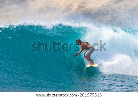 Surfing a Wave Lombok Island Indonesia