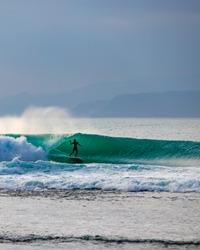 surfing action shot Indonesia sumatra