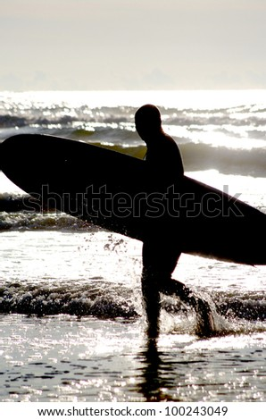 surfing at a nice beach outside at the sea