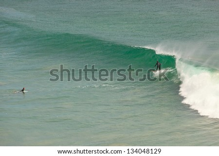 Surfing at Malibu beach. Big waves. USA. California.