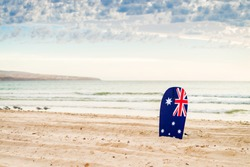 Surfing board with Australian flag at the beach