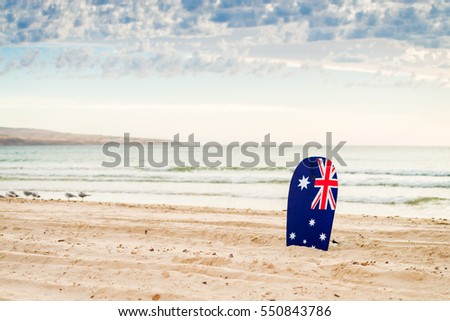 Surfing board with Australian flag at the beach #550843786