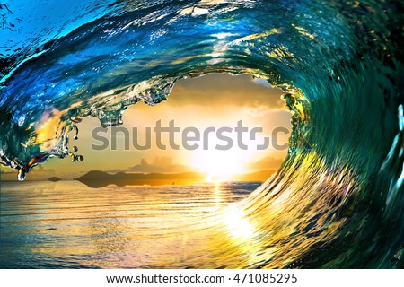 Surfing colored ocean wave falling down at sunset time