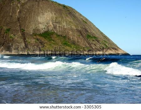 Surfing in Itacoatiara beach, Niterói, Rio de Janeiro, Brazil