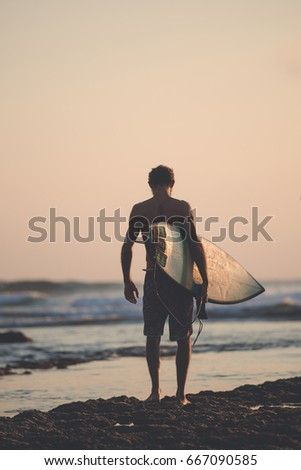 Surfing Themed Photo, Surfer walking towards the ocean.