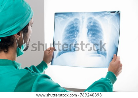 Surgeon analyzing a lung radiography