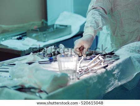surgeon and hand  tools