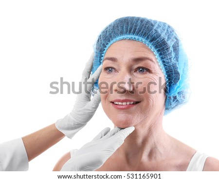 Surgeon examining female patient isolated on white