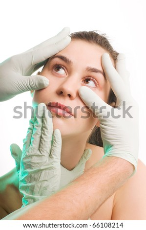 Surgeon gloves above woman face for plastic surgery, beauty treatment
