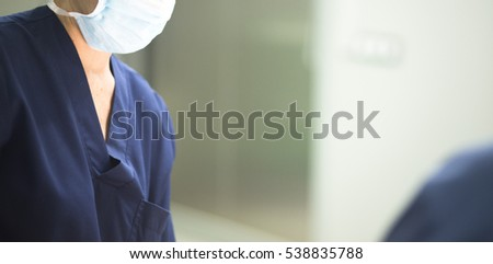 Surgeon in operating theater emergency room surgery in hospital clinic in blue surgical sterile uniform for operation. #538835788