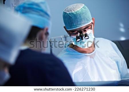 Surgeon operating live shot