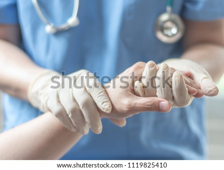 Surgeon, surgical doctor, anesthetist or anesthesiologist holding patient's hand for health care trust and support in professional surgical operation, medical anesthetic safety, ER healthcare concept Stock fotó ©