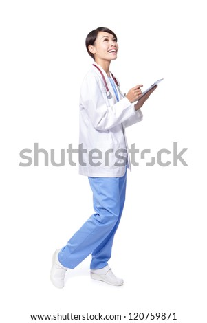 surgeon woman doctor smile using tablet pc and look to empty copy space in full length isolated on white background, model is a asian beauty