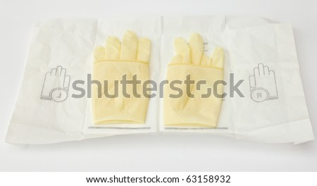 Surgical gloves preparing for surgery - stock photo