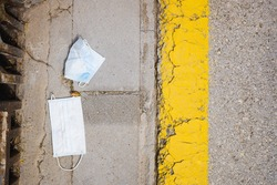 surgical masks dumped as garbage on the street by coronavirus bystanders.