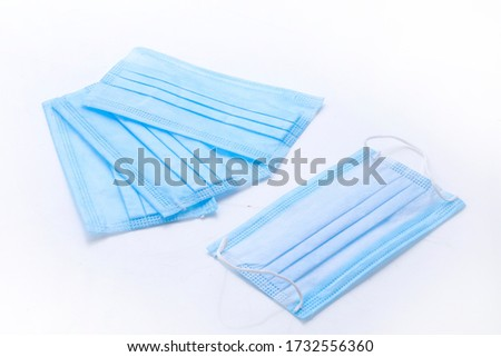 Surgical or medical mask with rubber ear straps. Typical 3-ply doctor mask to cover the mouth and nose. Doctor Medical face blue mask protection.face mask photography on white background