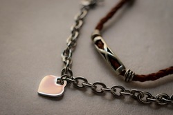 Surgical steel bracelet with heart charm. On white background